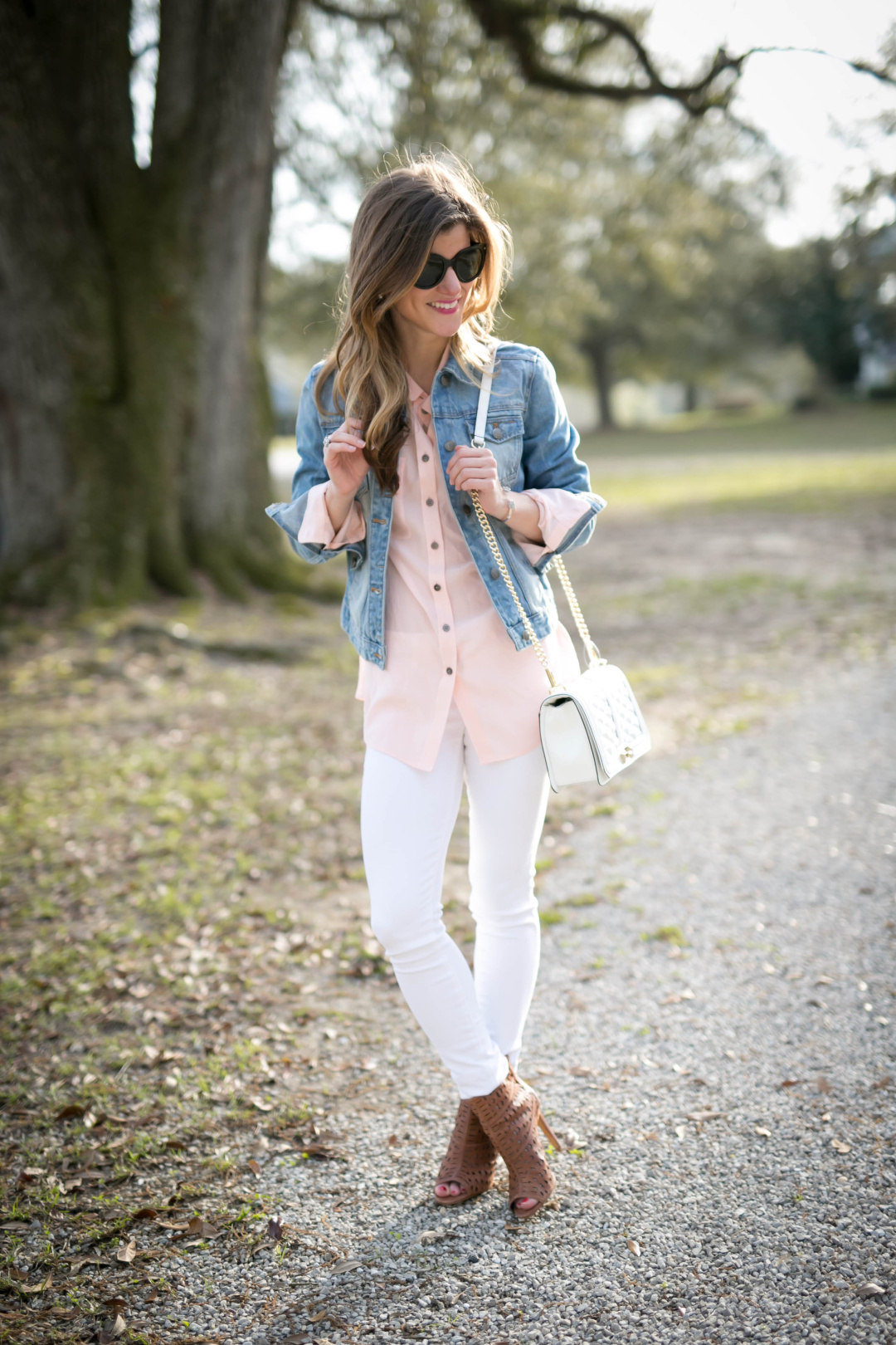white jeans outfit, transitional outfit, white jeans and pastel pink blouse, silk button down blouse, denim jacket with white jeans, denim on denim, brown peep toe booties and white jenas