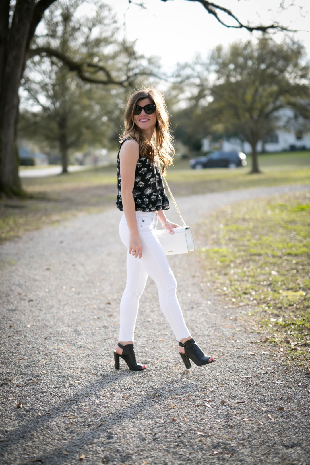 white jeans outfit, rebecca minkoff printed black peplum top, black peep toe sling back booties, fall outfit idea