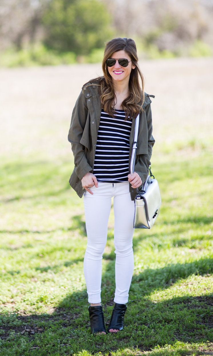 white jeans outfit - black peep toe booties, black and white striped tee, olive green military jacket, transitional outfit idea, fall outfit idea