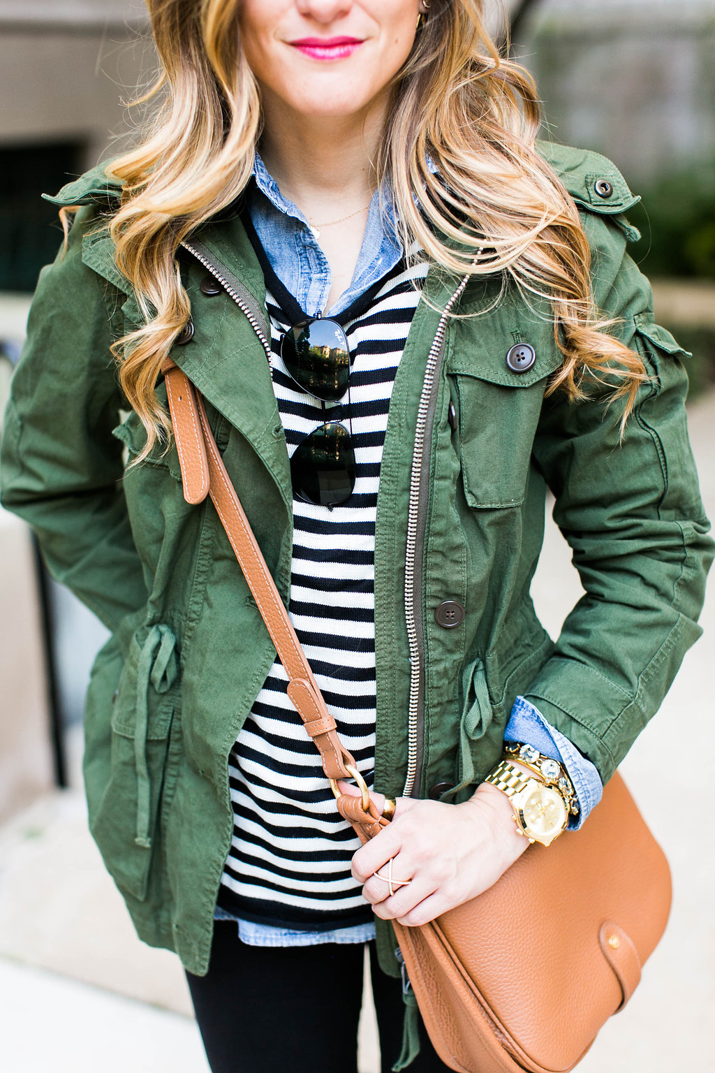 striped sweater, chambray, utility jacket, cognac leather crossbody, black jeans
