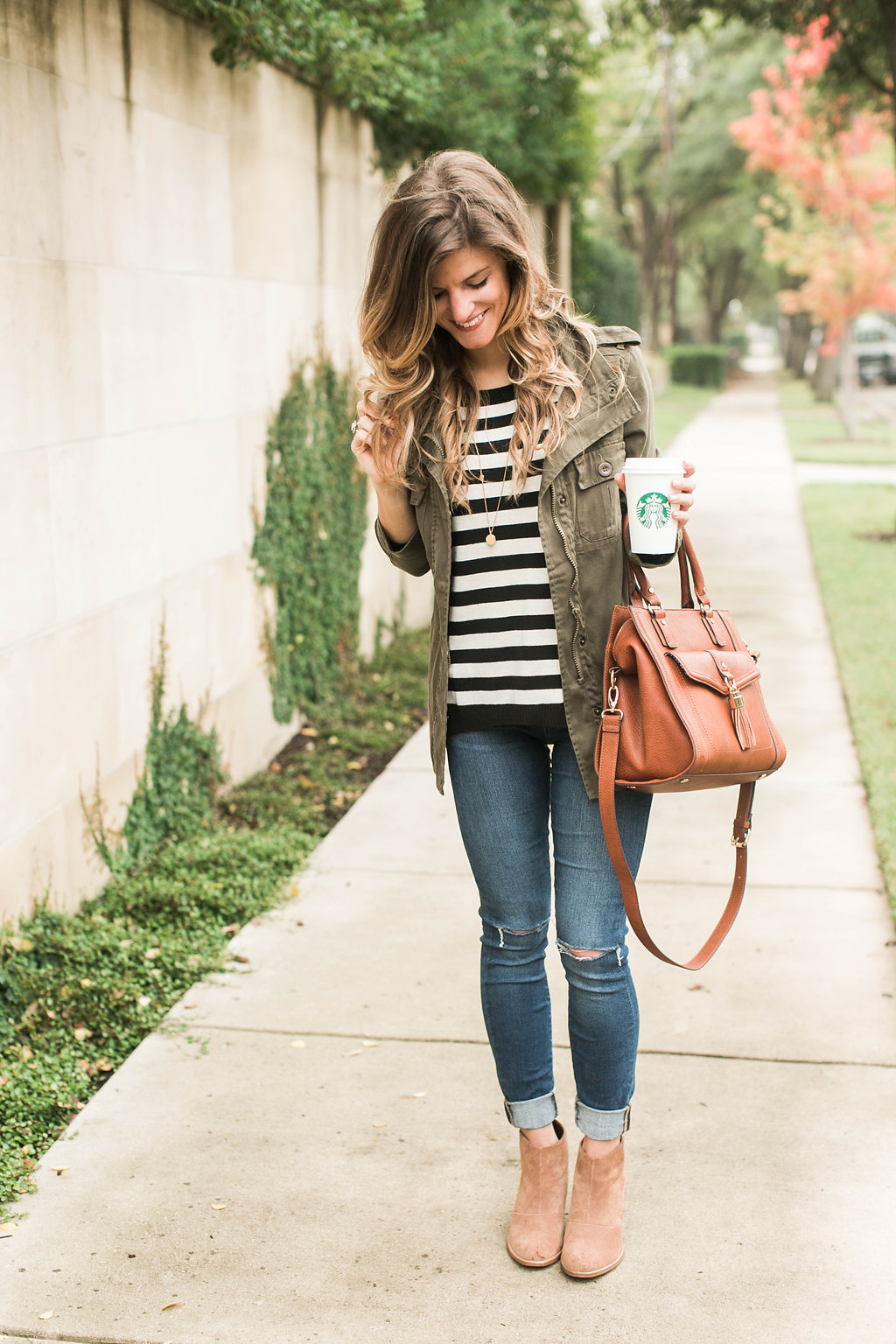 7c407bbb321 black and white stripes and utility jacket and coganc booties and brown bag