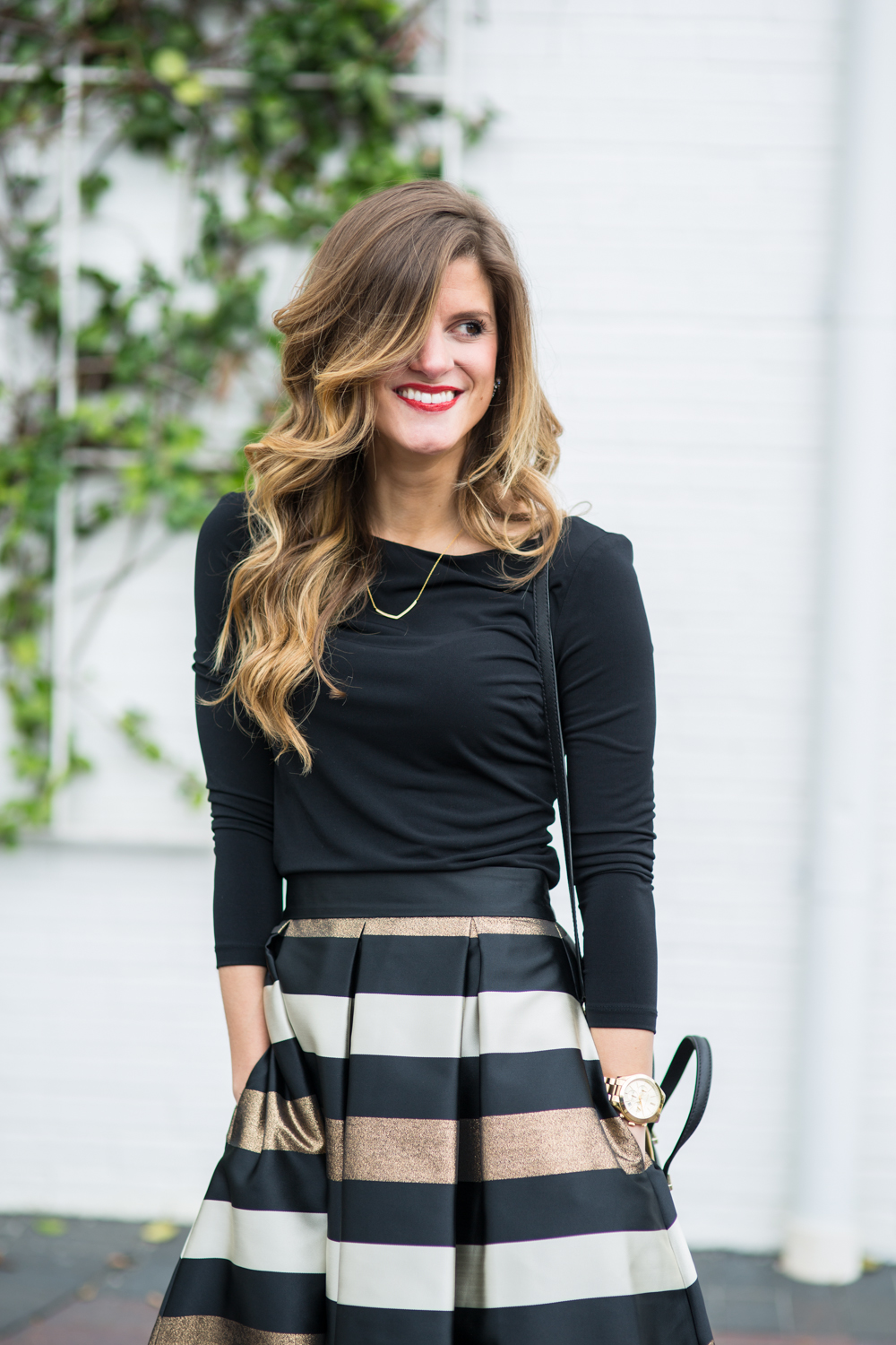 what to wear to holiday office party, holiday office party outfit idea, what to wear to company christmas party, midi skirt outfit, eliza j midi skirt with black turtleneck, kate spade bag, statement necklace