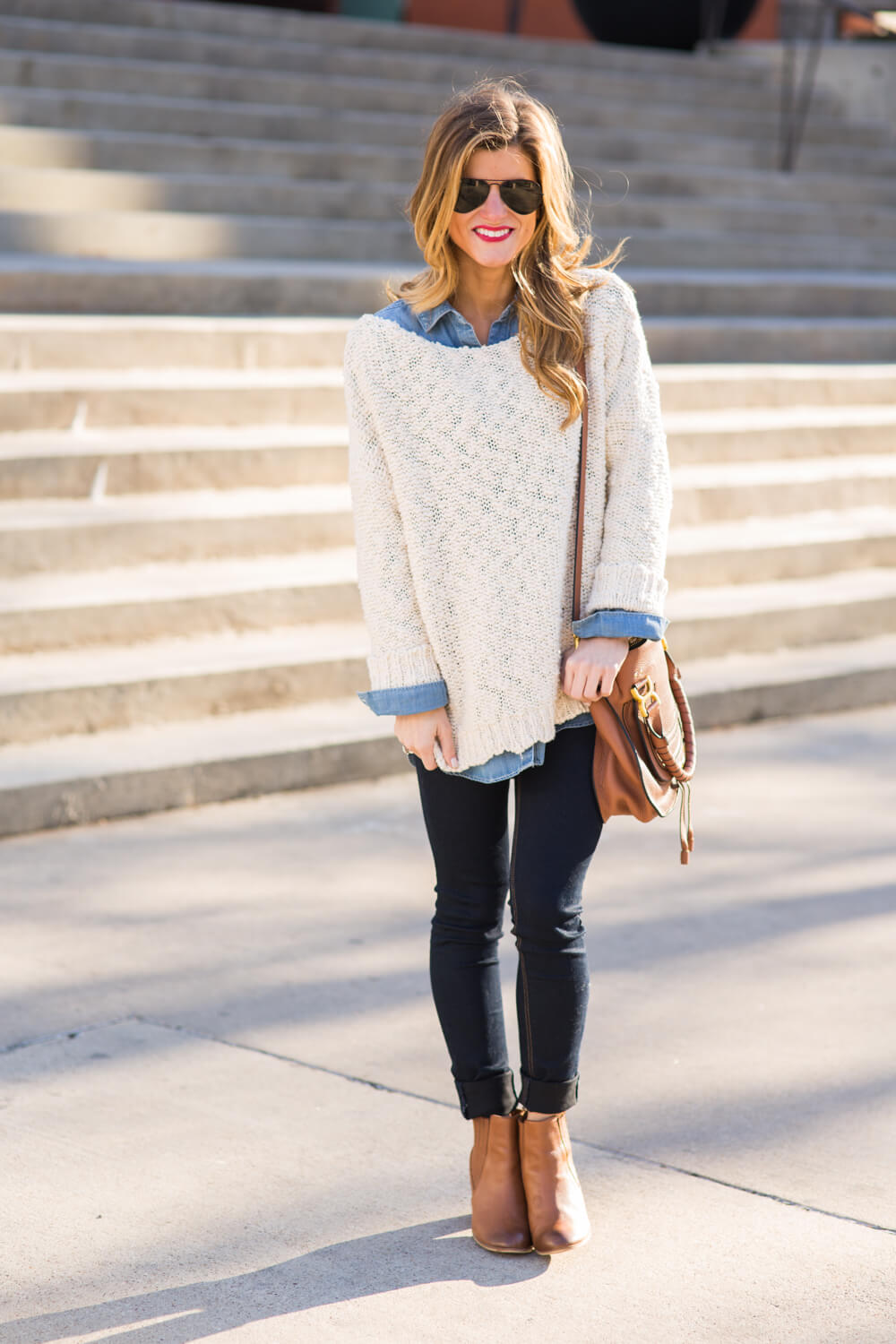 white sweater + chambray shirt + skinny jeans + booties + crossbody bag