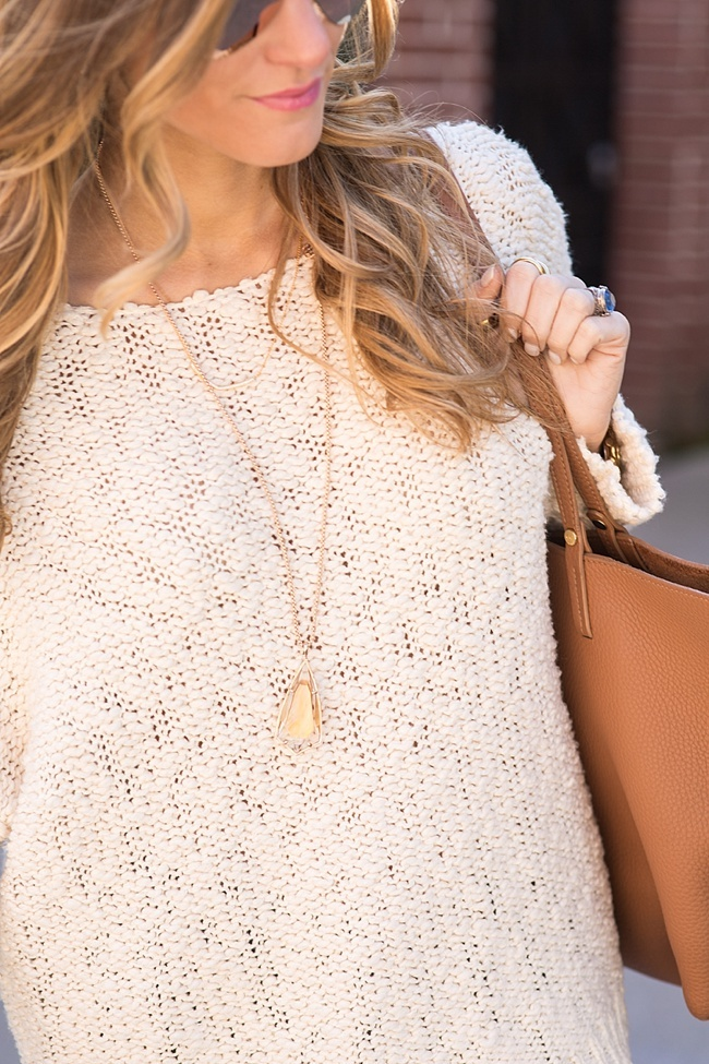 Brightontheday wearing knit cream sweater with kendra scott necklace and cognac tote