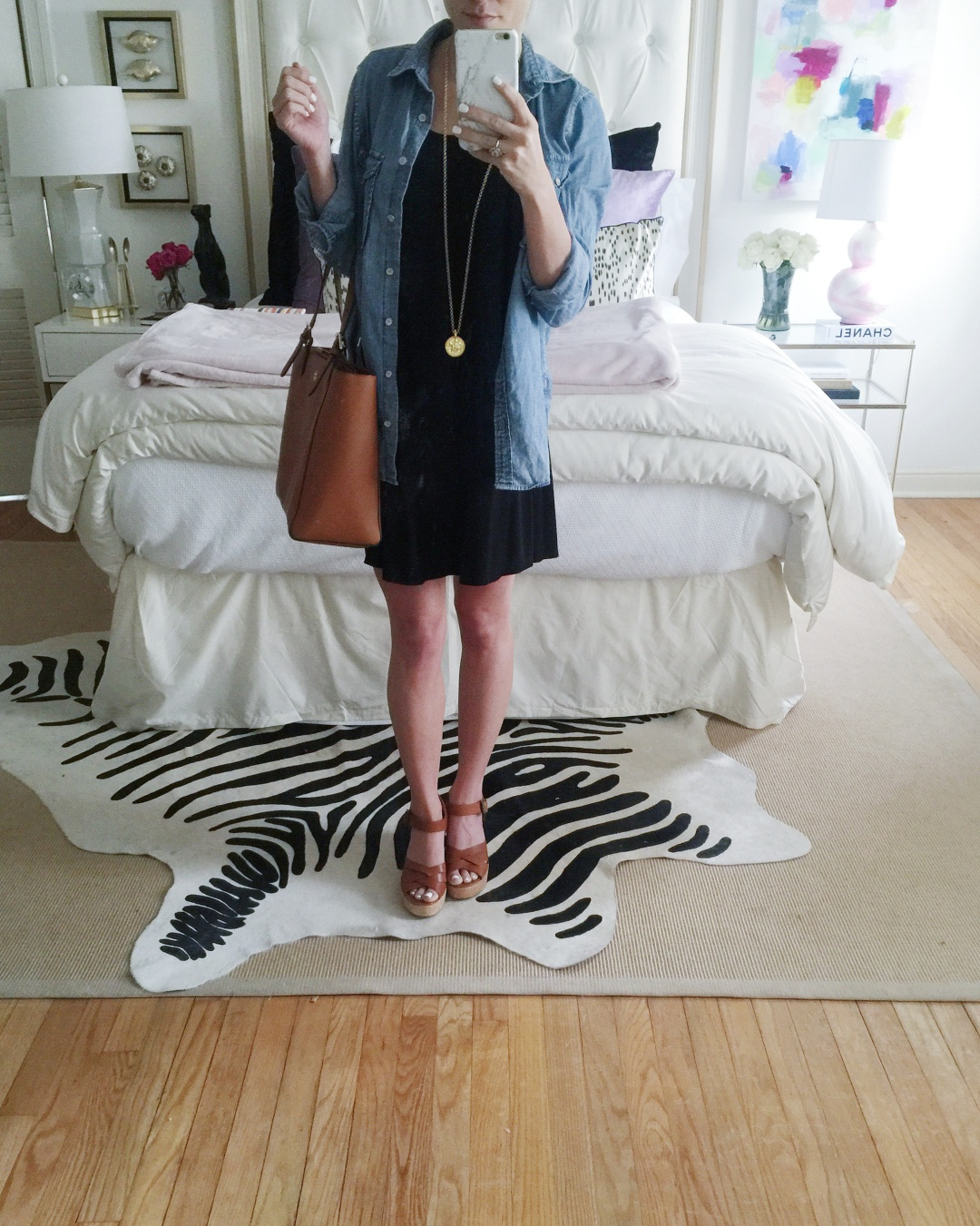 @brightonkeller mirror selfie wearing black mini swing dress with chambray worn as a cardigan and gold pendant necklace