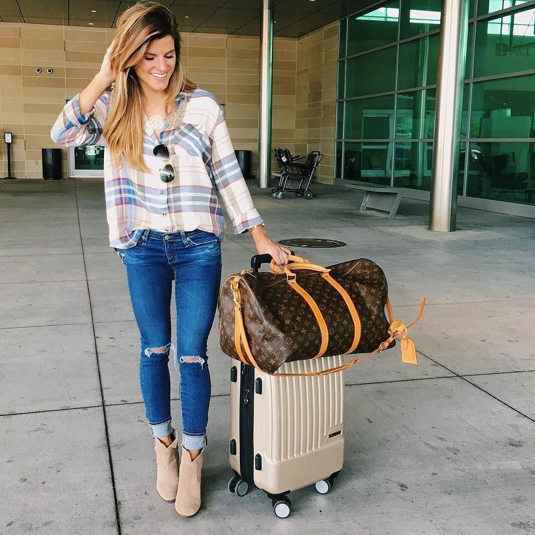 brighton keller at the airport featuring plaid airport outfit