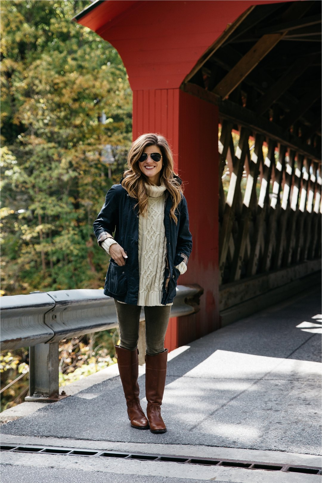 Fall outfit, tory burch riding boots, barbour jacket, olive green pants, oversized cableknit turtleneck sweater covered bridge in Vermont
