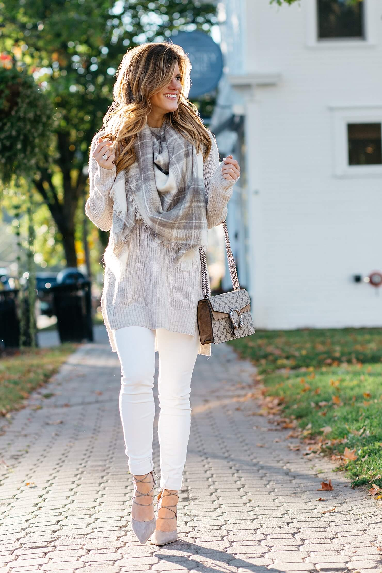 oatmeal neutral tunic sweater, sam edelman lace up heels, gucci crossbody, plaid scarf, neutral fall white jeans outfit