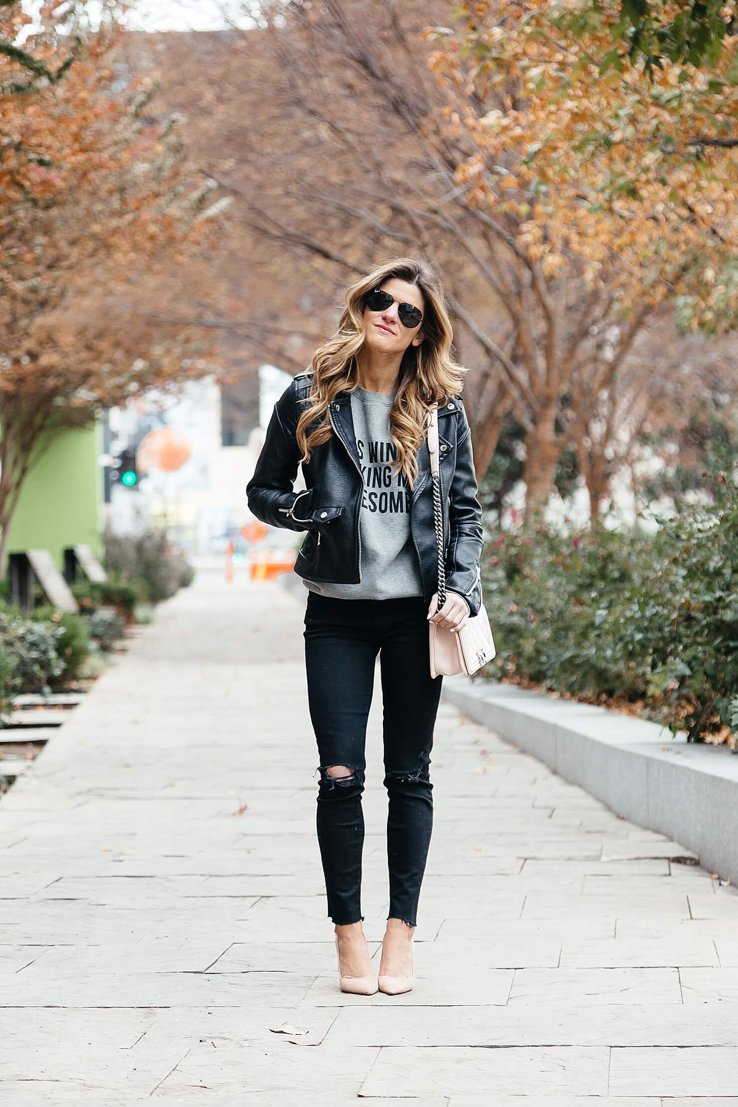 moto jacket outfit, dressing up a sweatshirt, all black outfit with pink