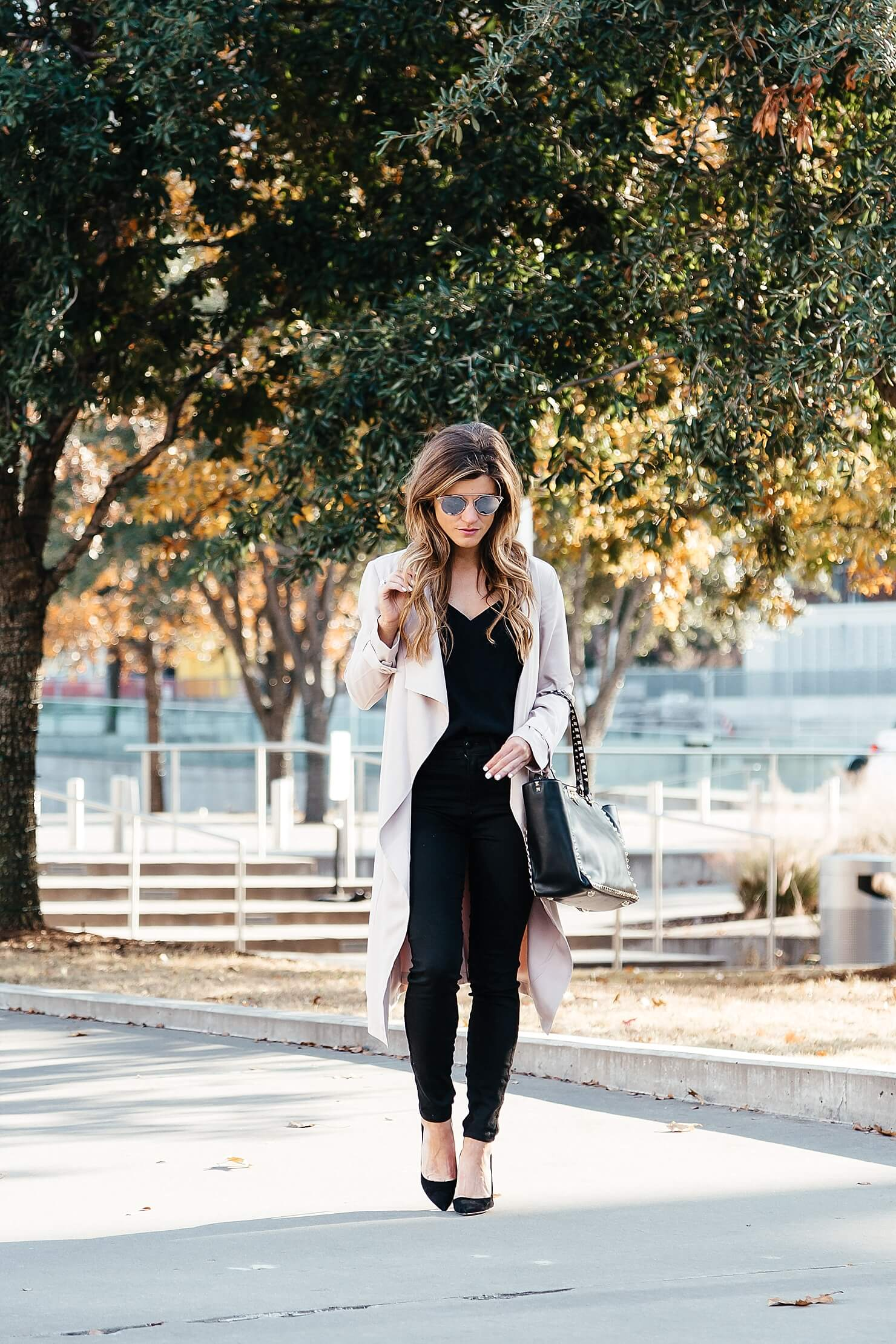 all black outfit, blush pink duster coat, pink trench coat, black on black going out look