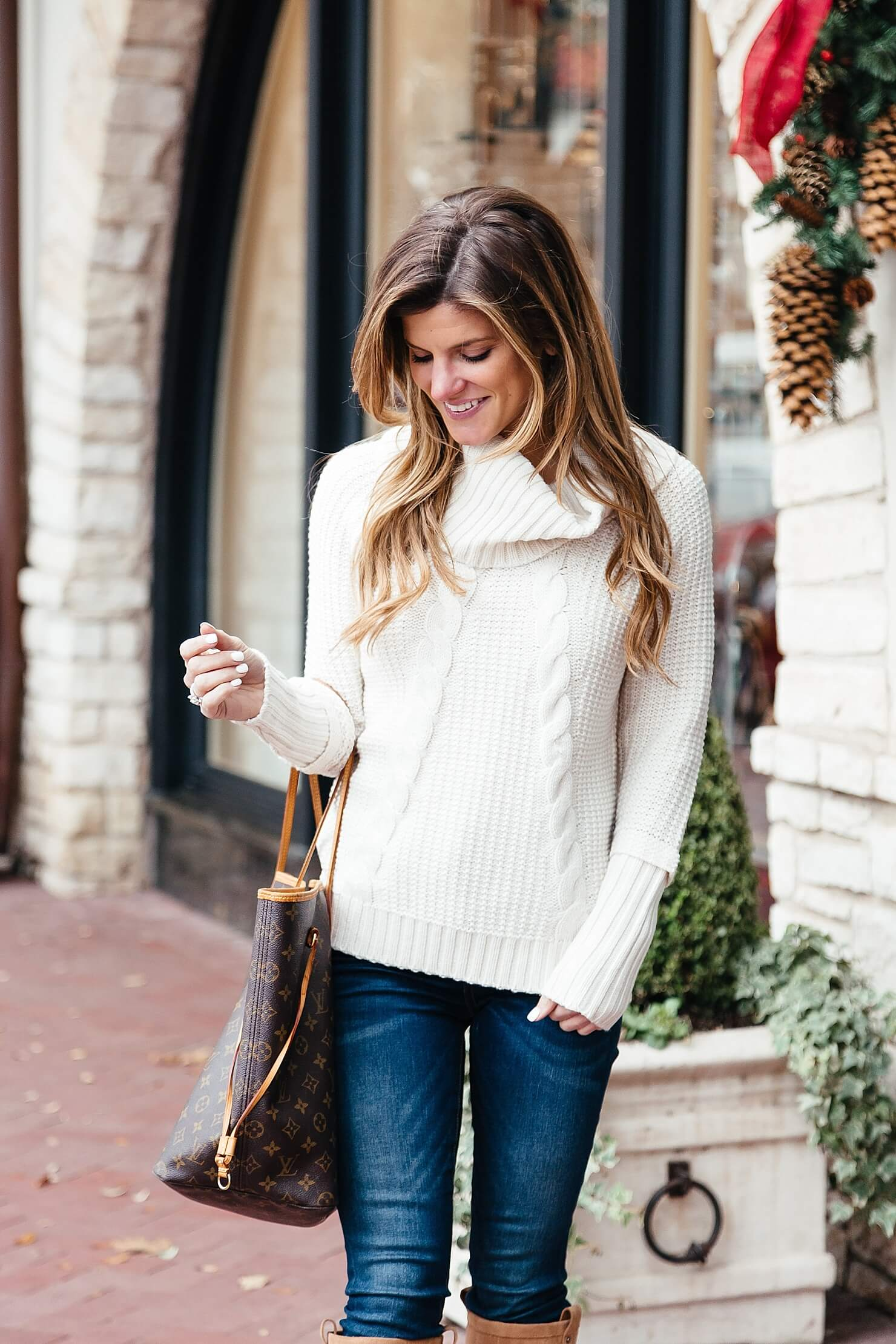 Brighton the day styling cream turtleneck sweater with denim jeans