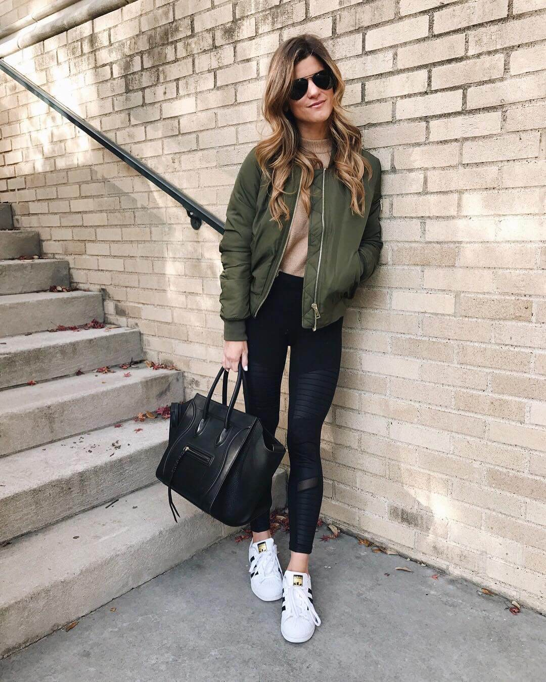 athleisure look with bomber jacket and moto leggings