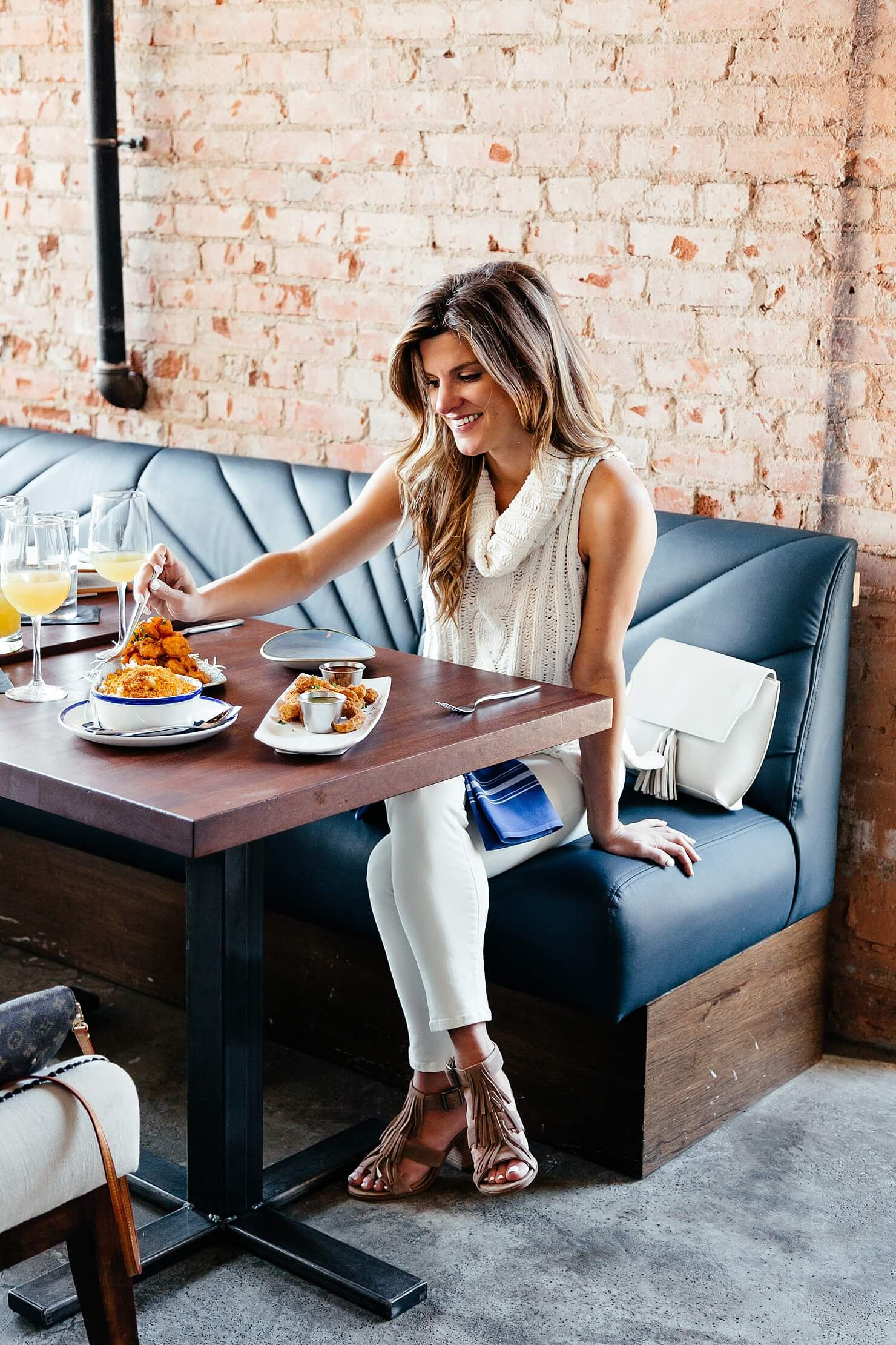 brighton keller at Stirr Dallas having lunch wearing sole society