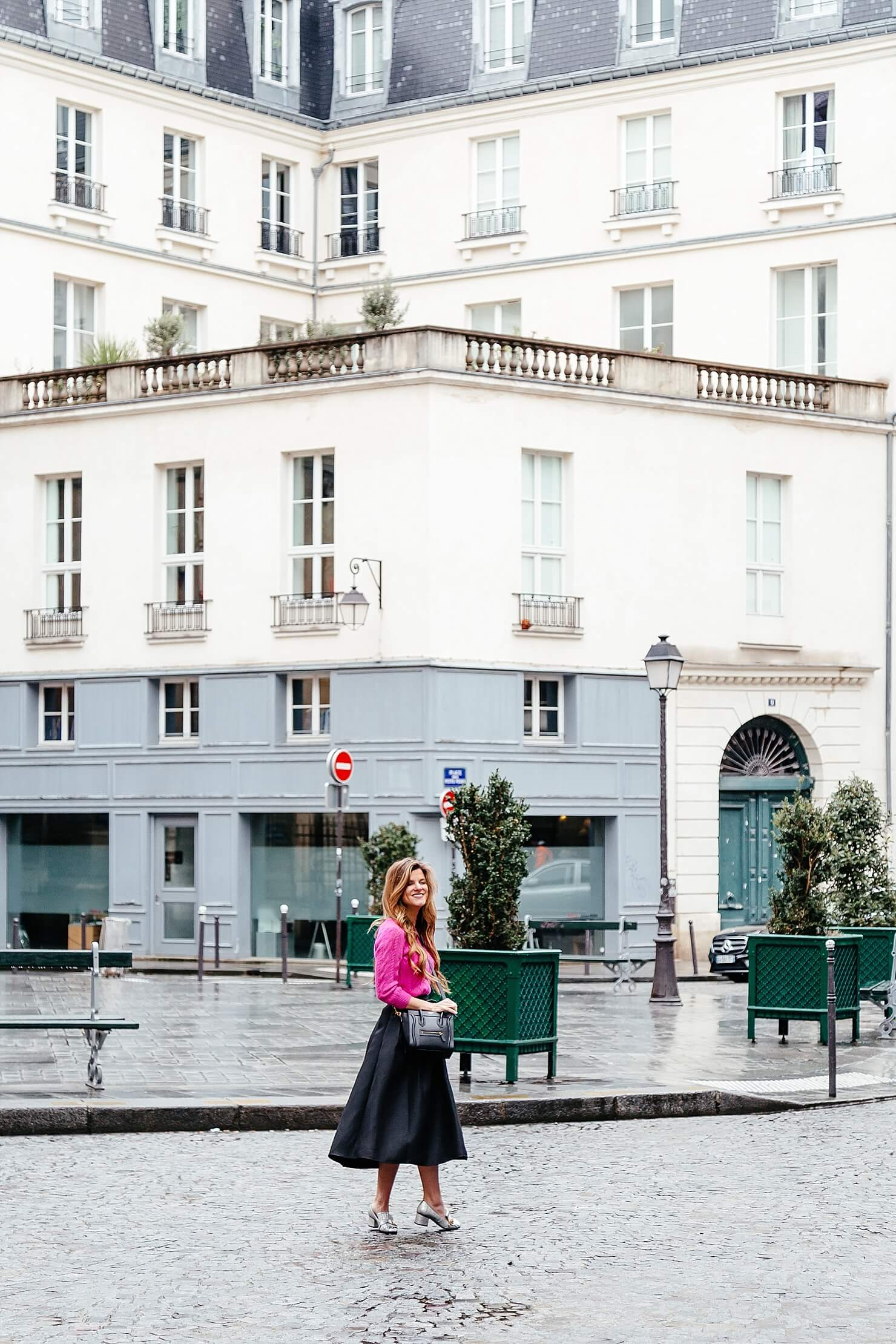 Black midi skirt, hot pink sweater, gucci loafers in Paris