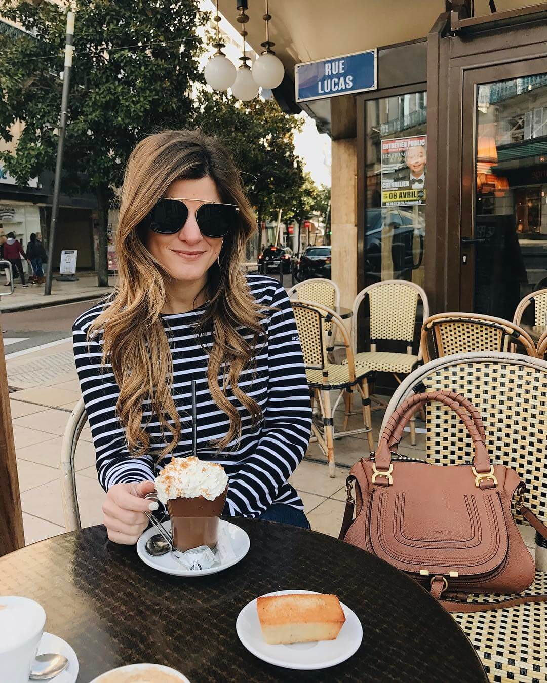 brighton keller drinking hot chocolate in vichy, france wearing striped top