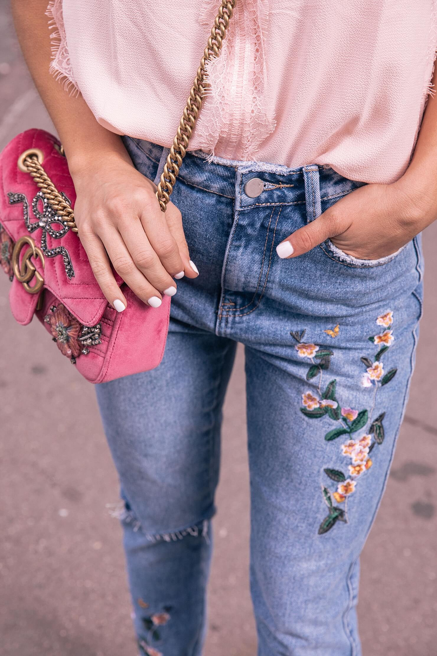 rose embroidered jeans with lace sleepless blouse and gucci velvet bag