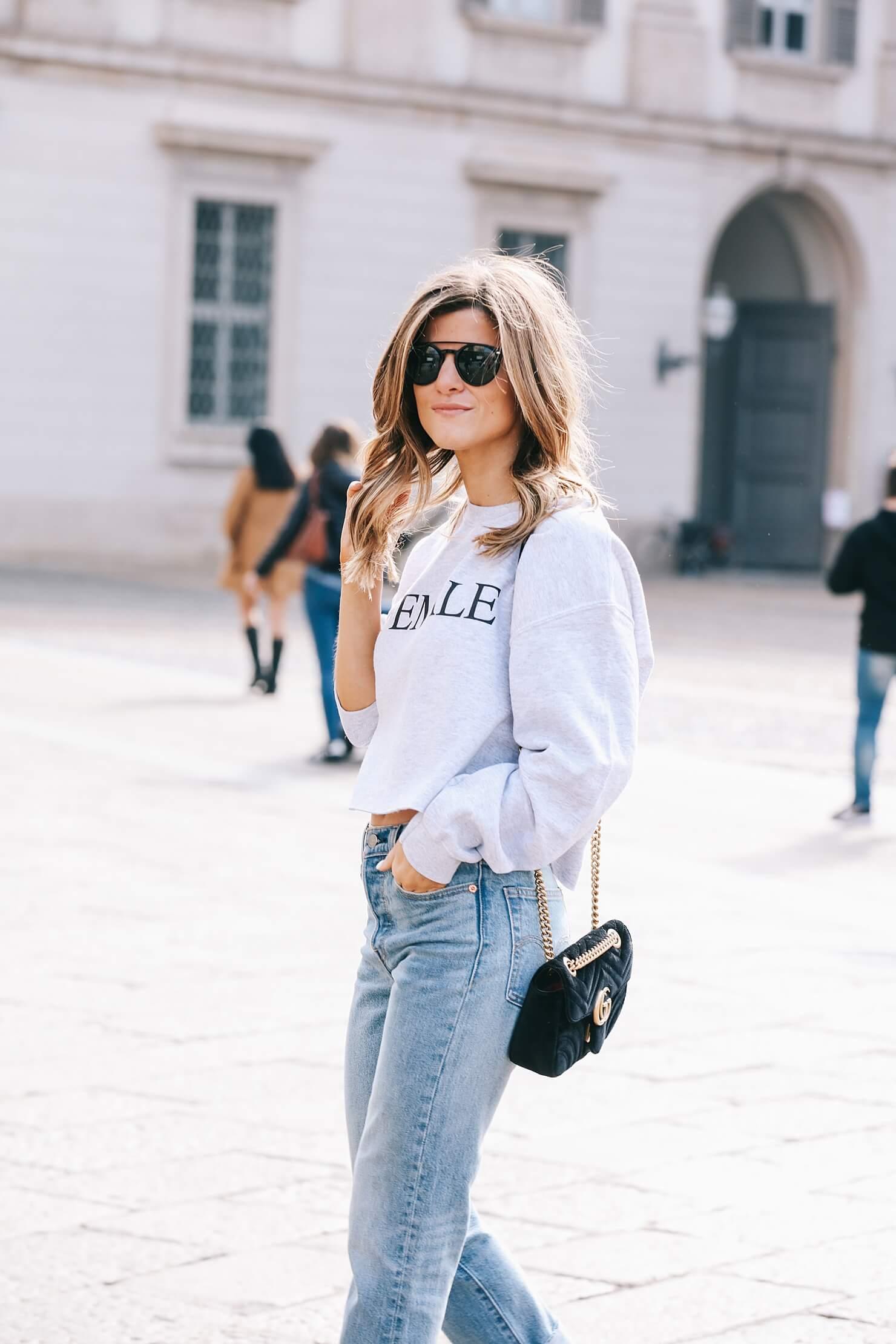 Female print sweatshirt, Levi's wedgie, black sock booties // political slogan trend