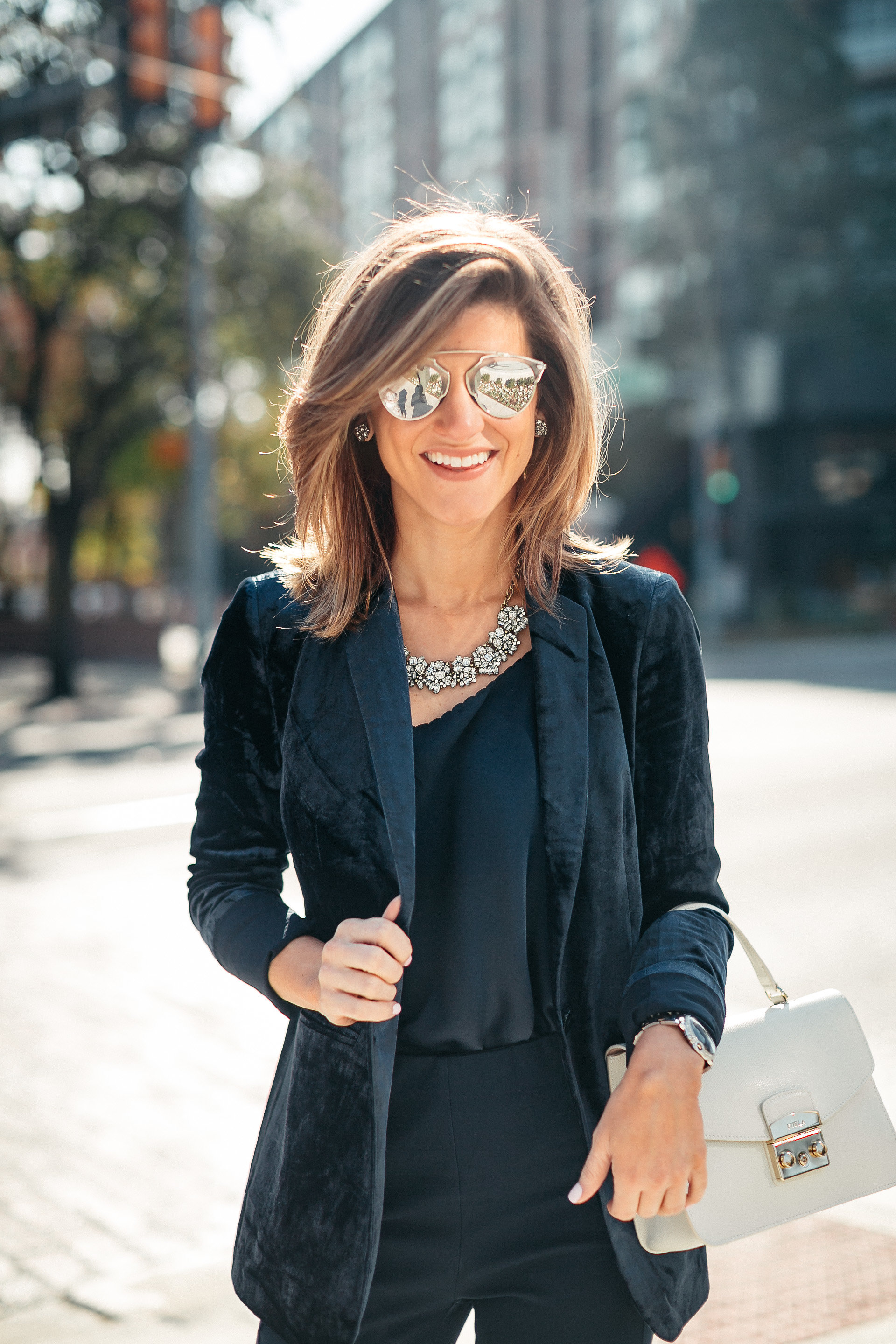 Navy jacket, camisole, blue simone pants, blue velvet pumps, and statement jewelry, dior sunglasses, white furla bag