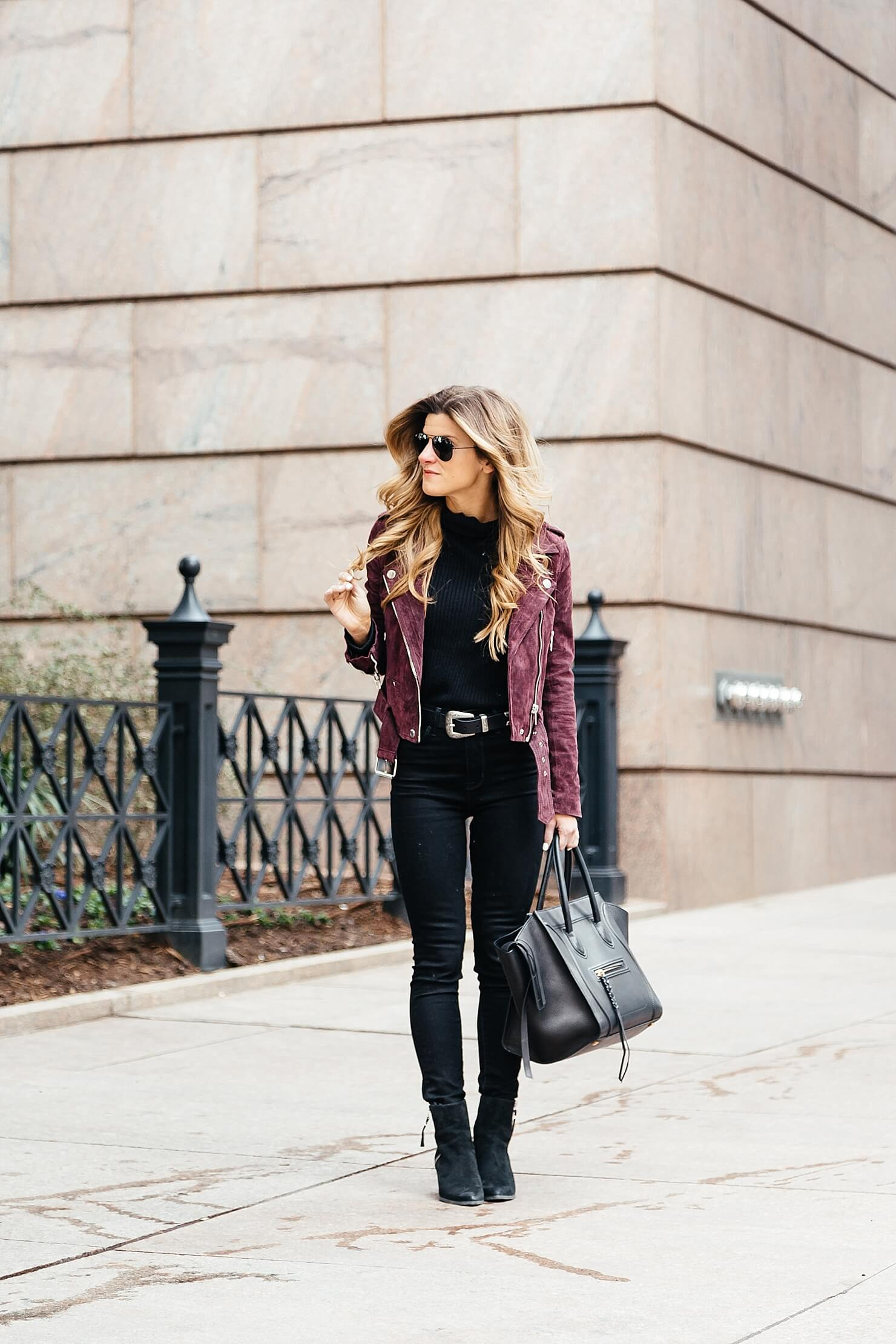 all black winter outfit with western belt and Burgundy suede Moto jacket