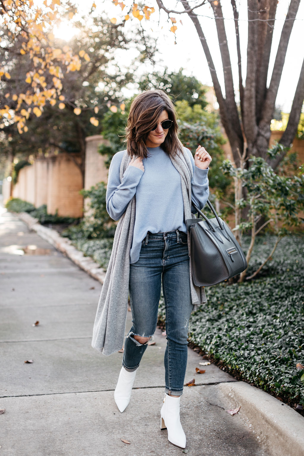 white booties outfit blue sweater grey cashmere scarf grey celine bag 1