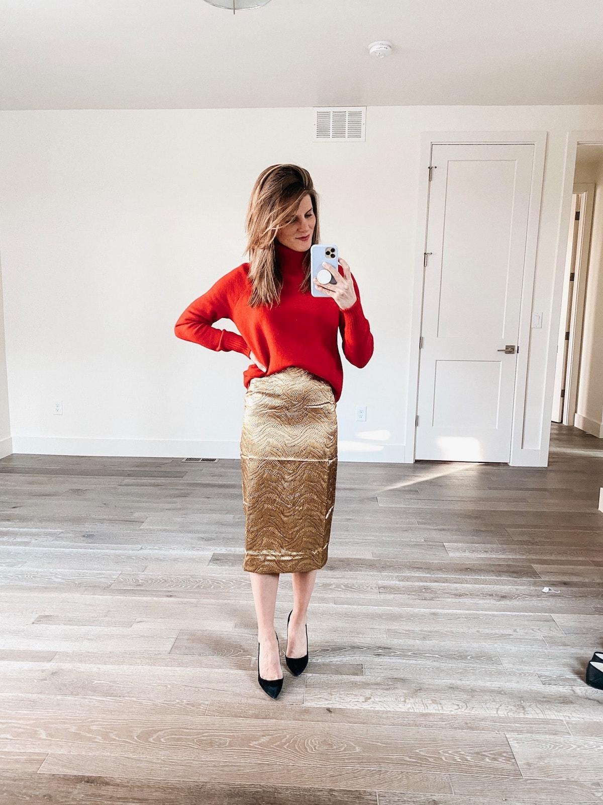 Brighton Keller wearing red sweater and JCrew gold skirt