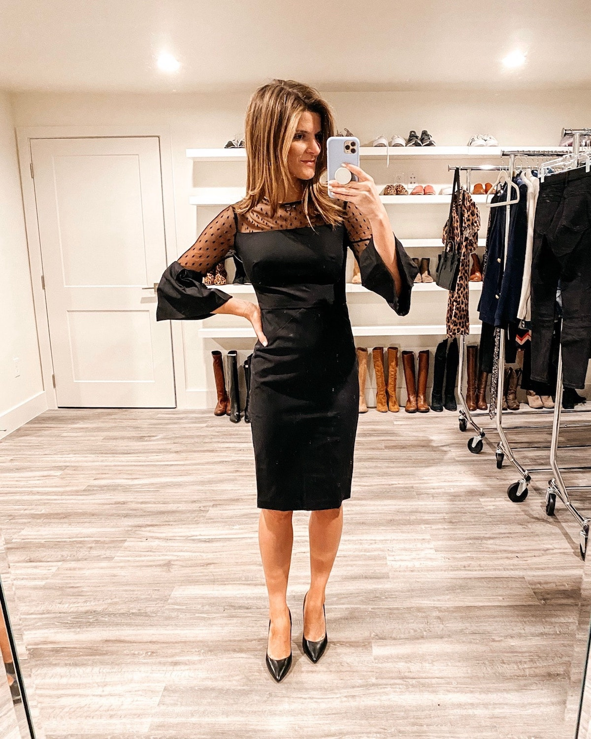 Brighton Keller wearing black dress for holiday work party