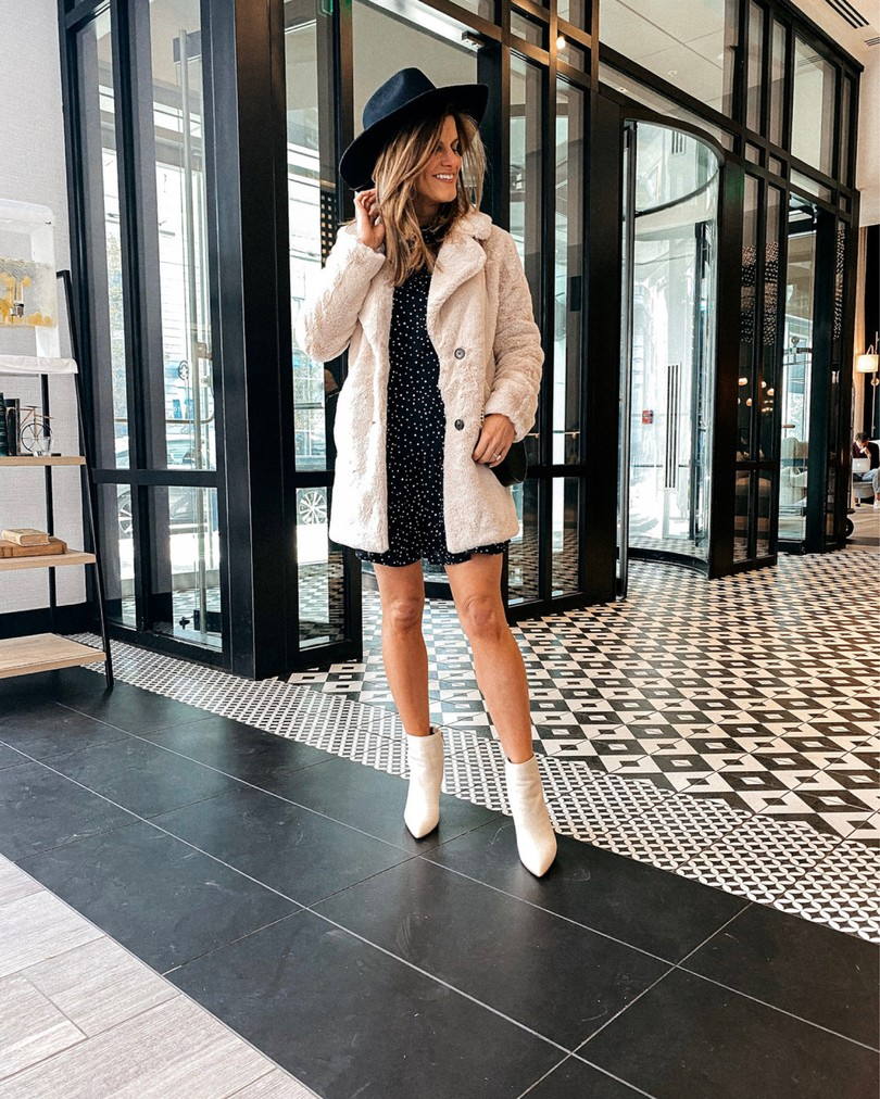 brighton keller fur jacket black dress black hat cream booties