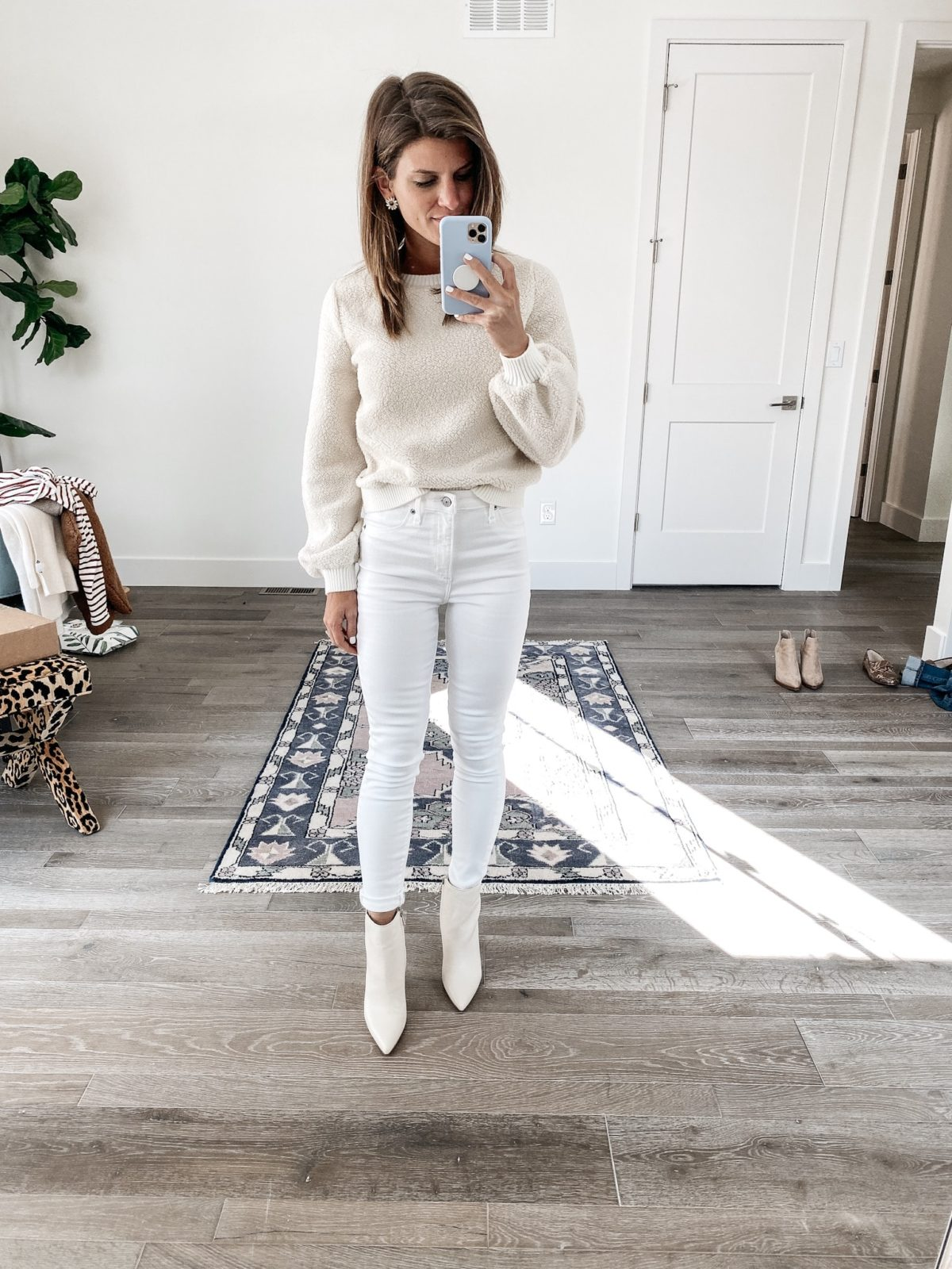 rolled up and tucked in winter white jeans