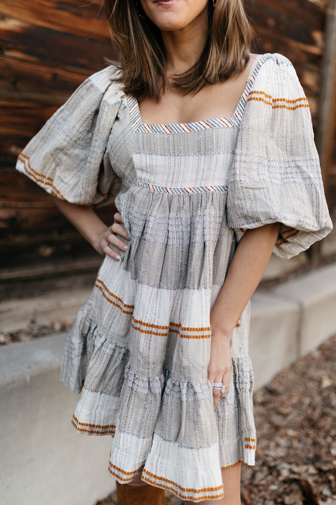 brighton keller wearing free people spring dress puff sleeves from verishop with tall boots
