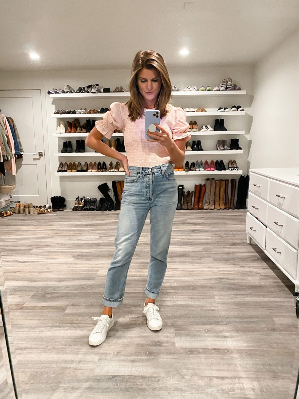 Brighton Keller wearing pink top, mom jeans and white sneakers
