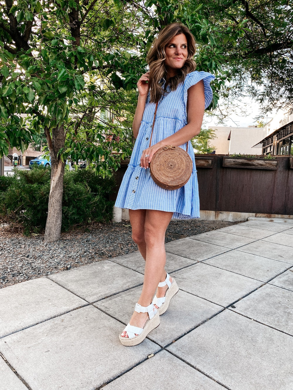 brighton butler wearing free people blue check swing dress with white platform sandals, fourth of July outfit idea
