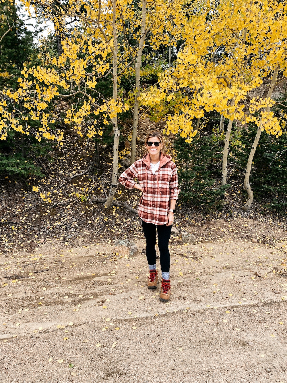 brighton butler wearing plaid shirt with hiking boots, hiking outfit, hiking boots