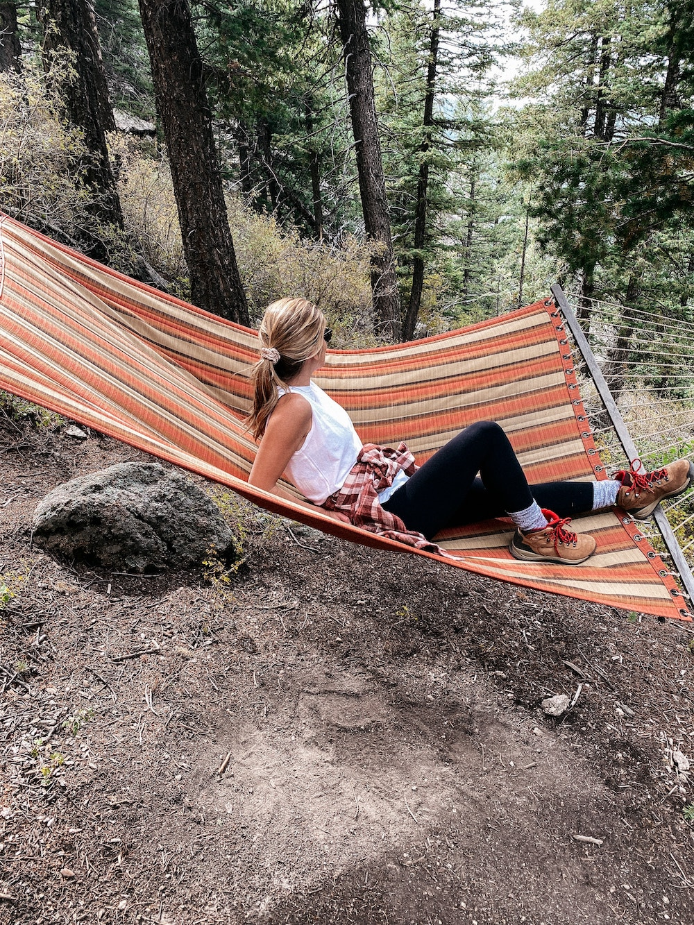 brighton butler at qroadmoor cloud camp sitting on hammock