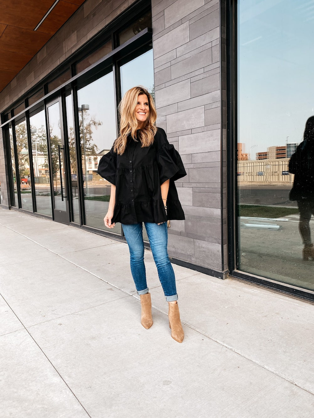 Black TopShop Blouse Nordstrom, brighton butler pregnancy outfit with oversized black shirt skinny jeans and booties, fall outfit
