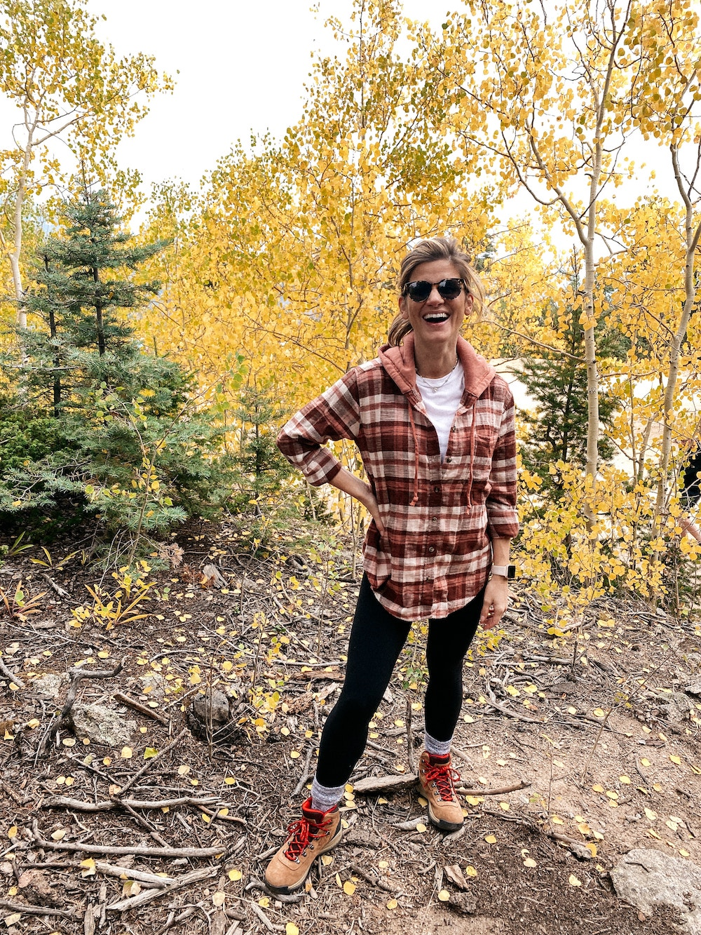 brighton butler mountain hiking outfit, plaid shirt wrapped around waist with leggings and hiking boots