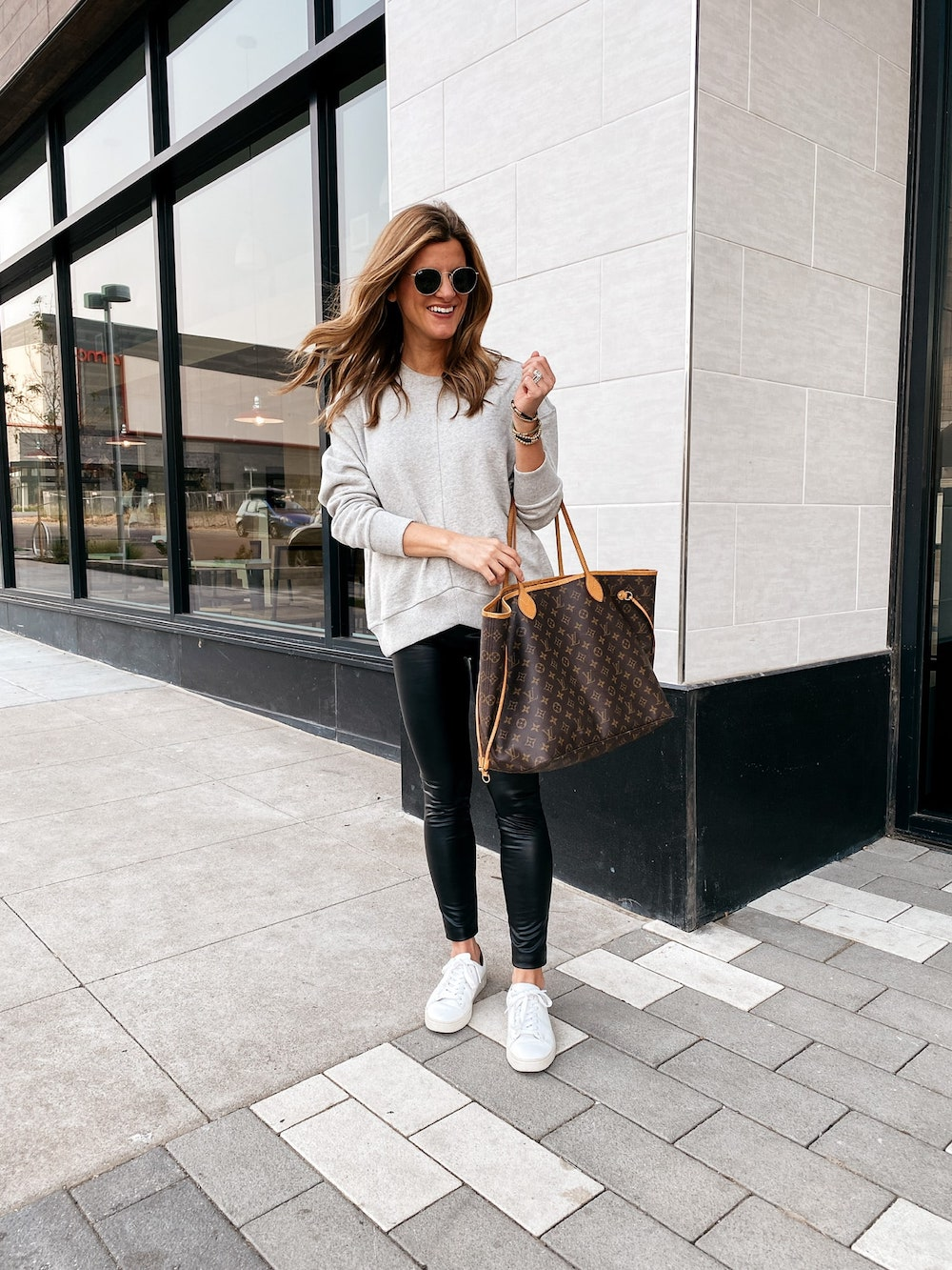 how to style white sneakers, white sneakers outfit, grey sweatshirt, black faux leather leggings, white fry sneakers, how to style white sneakers