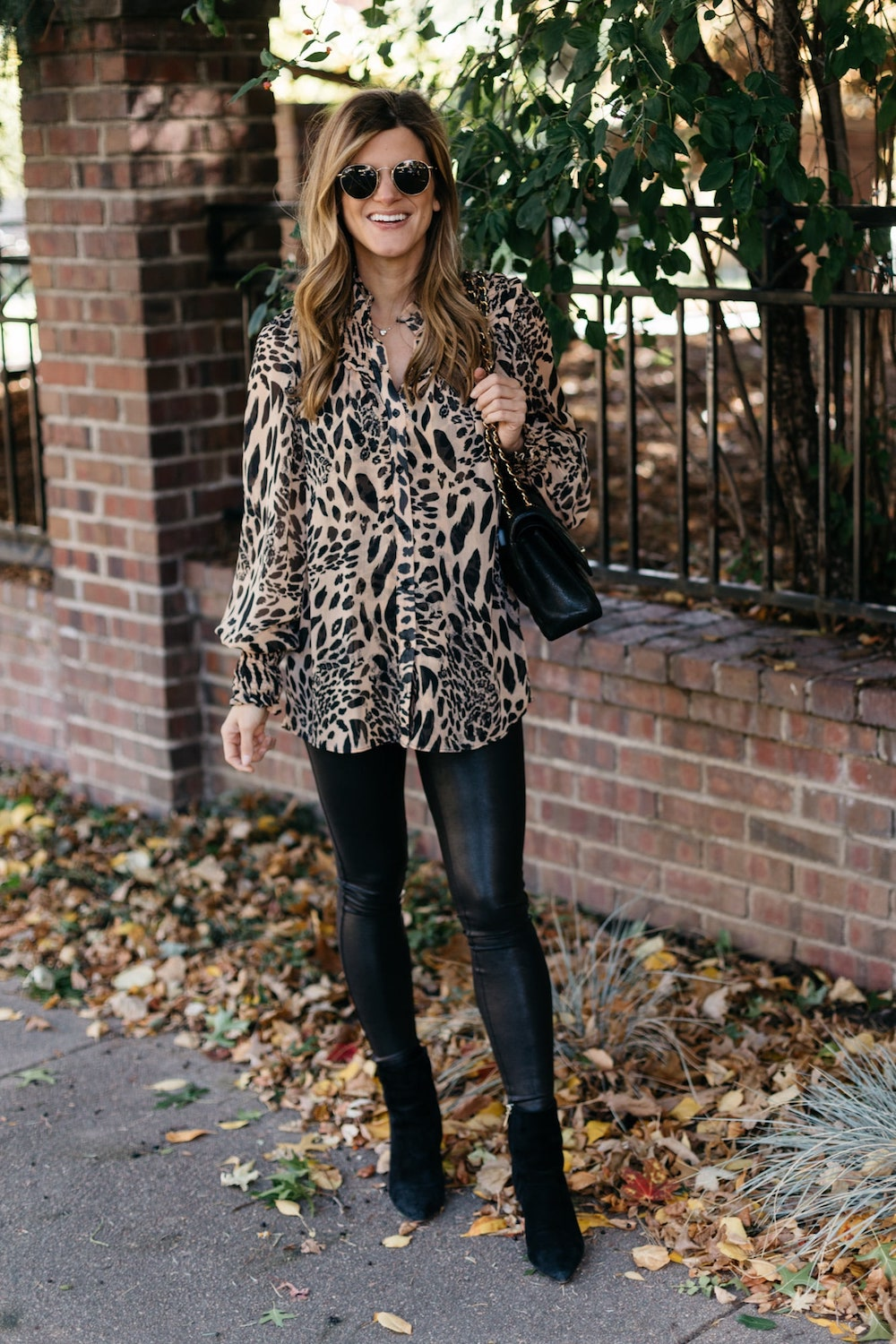 Brighton butler wearing Spanx faux leather leggings with Topshop Animal print top