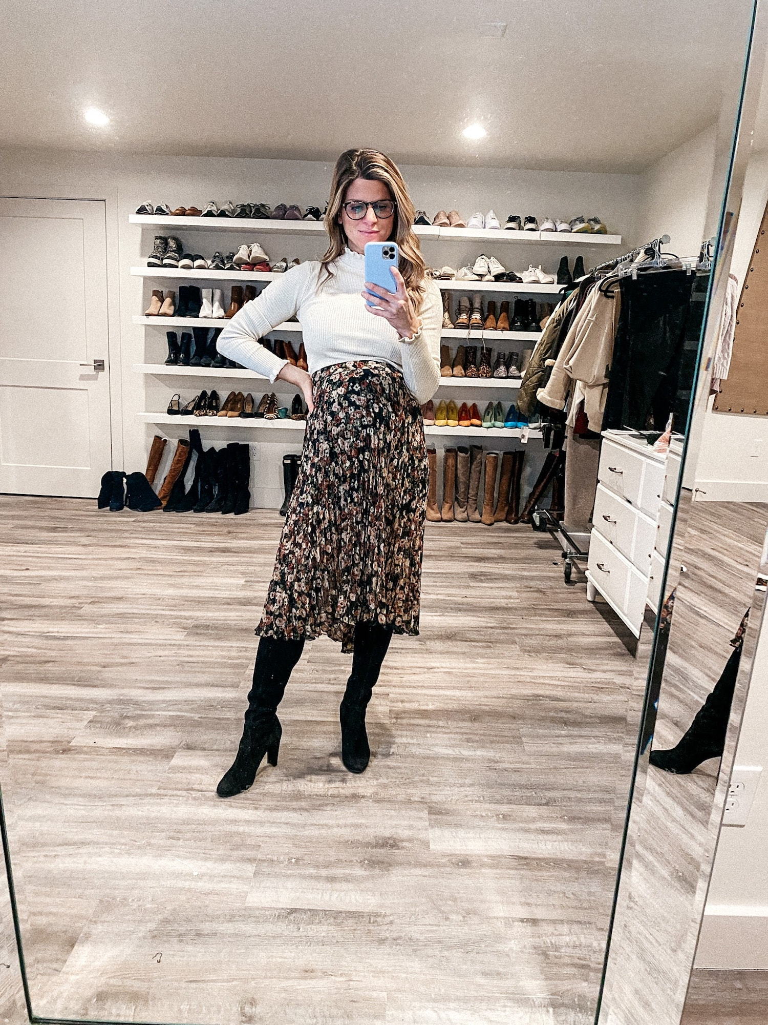 Brighton Butler wearing Abercrombie midi skirt and tan mock neck sweater from express