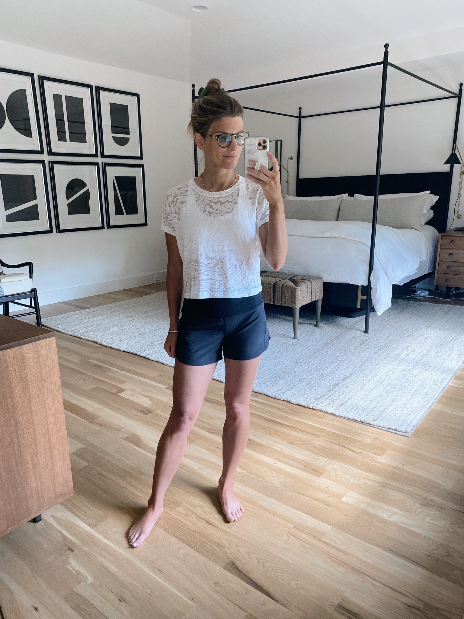 Brighton butler wearing Lululemon cates tee veil and high rise speed up shorts in black, workout outfit