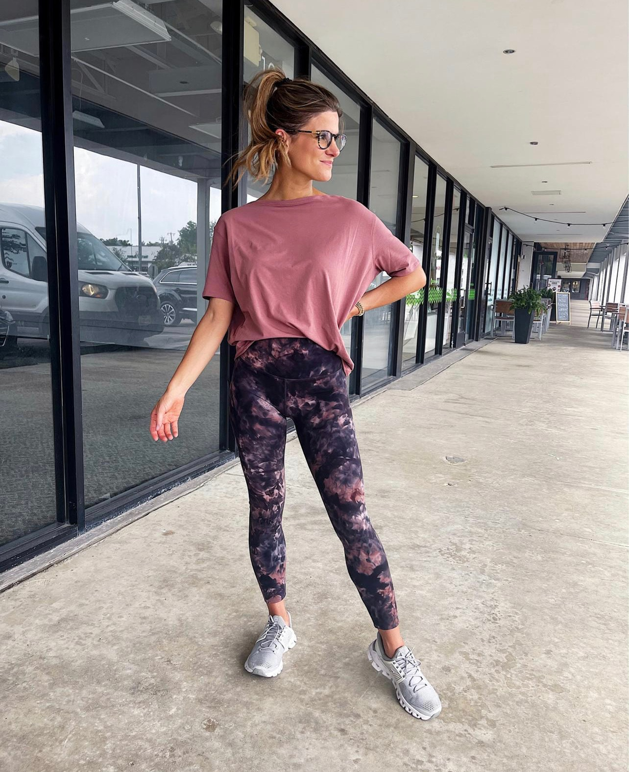 Brighton Butler wearing Lululemon align leggings tie dye and back in action tee rose color and grey sneakers tennis shoes