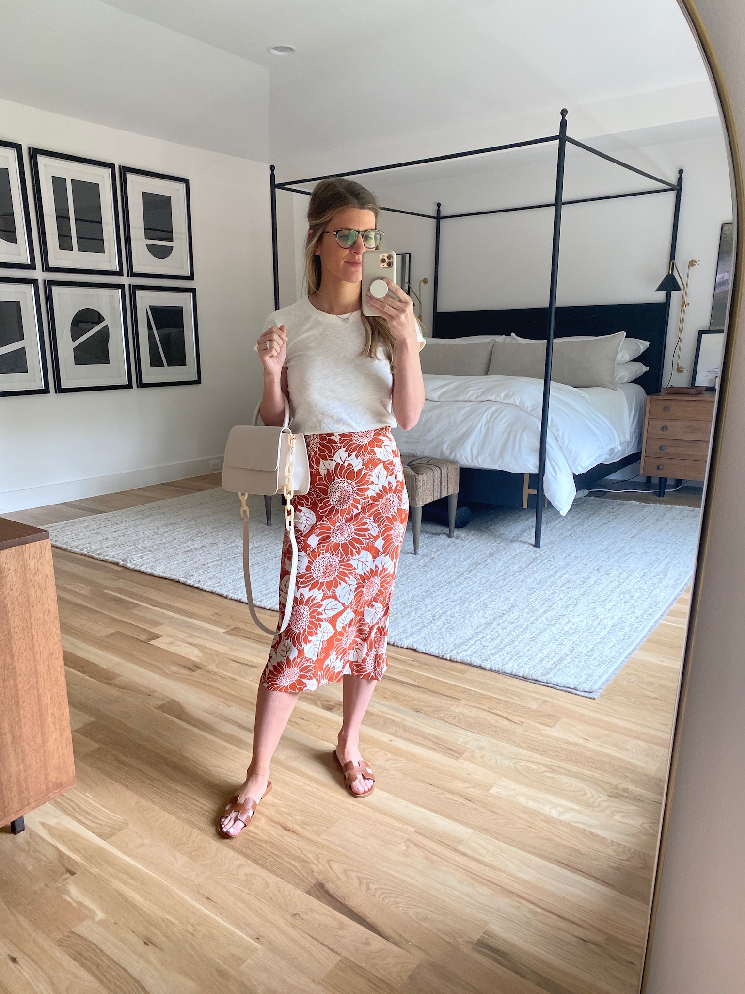 Brighton Butler wearing slip skirt floral from madewell and white tee and brown sandal from DSW