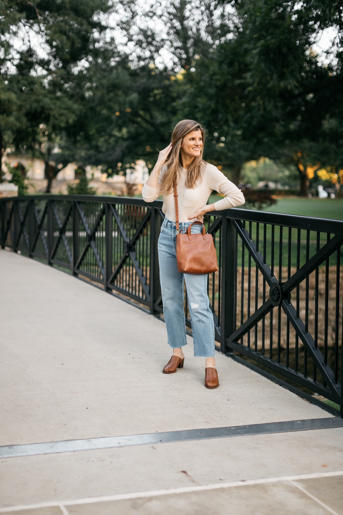 Brighton Butler transitional look, Levi's ribcage denim wide leg, mules, cream sweater, simple transitional outfit
