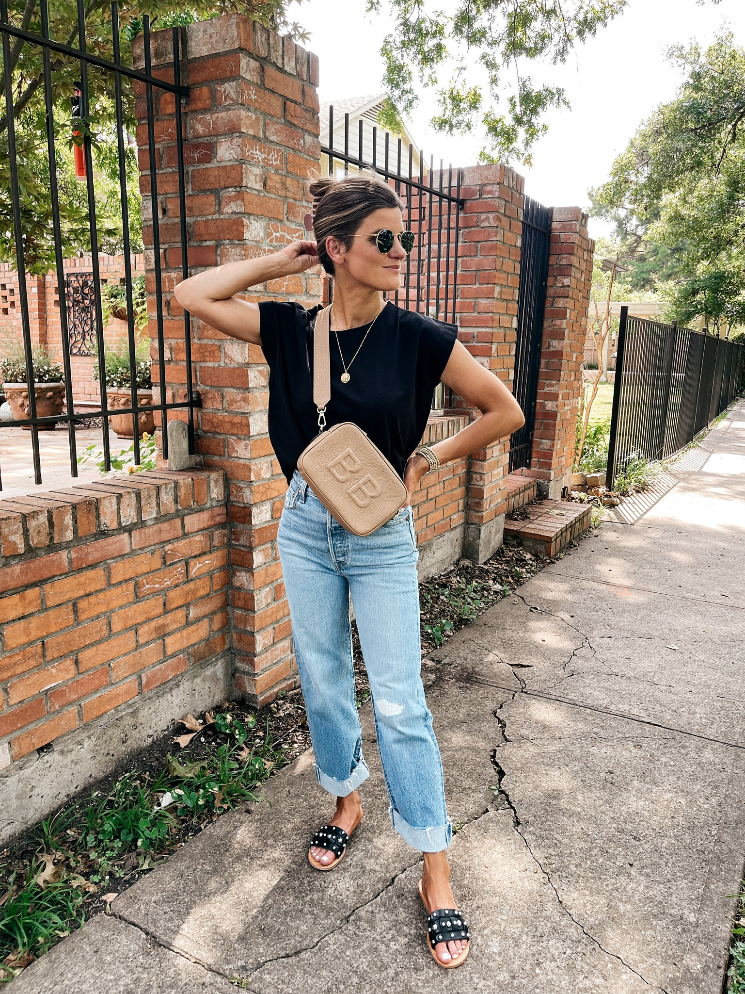 Brighton Butler wearing black tee and light wash jeans