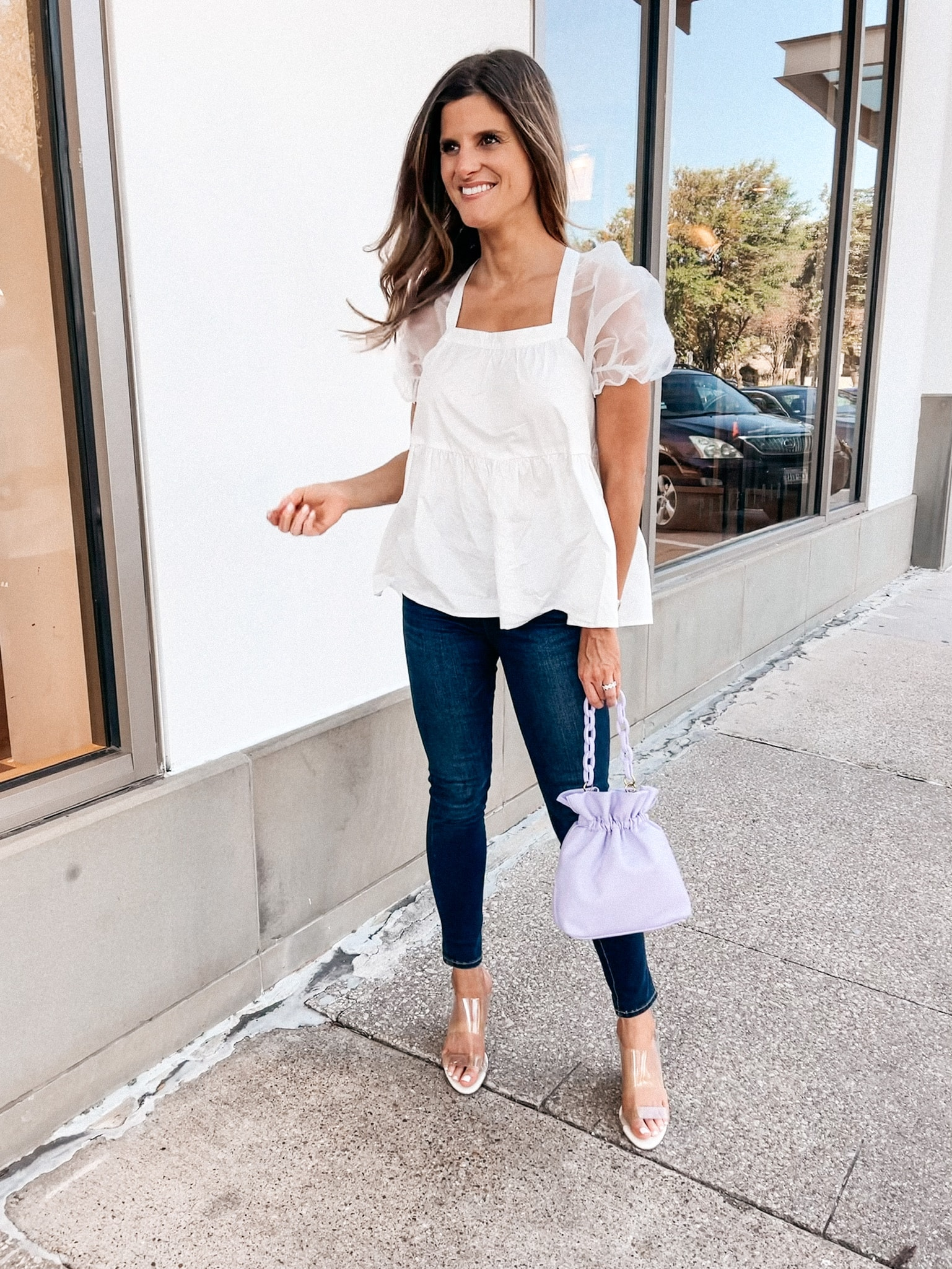 Brighton Butler wearing white puff sleeve top from tuckernuck and jeans