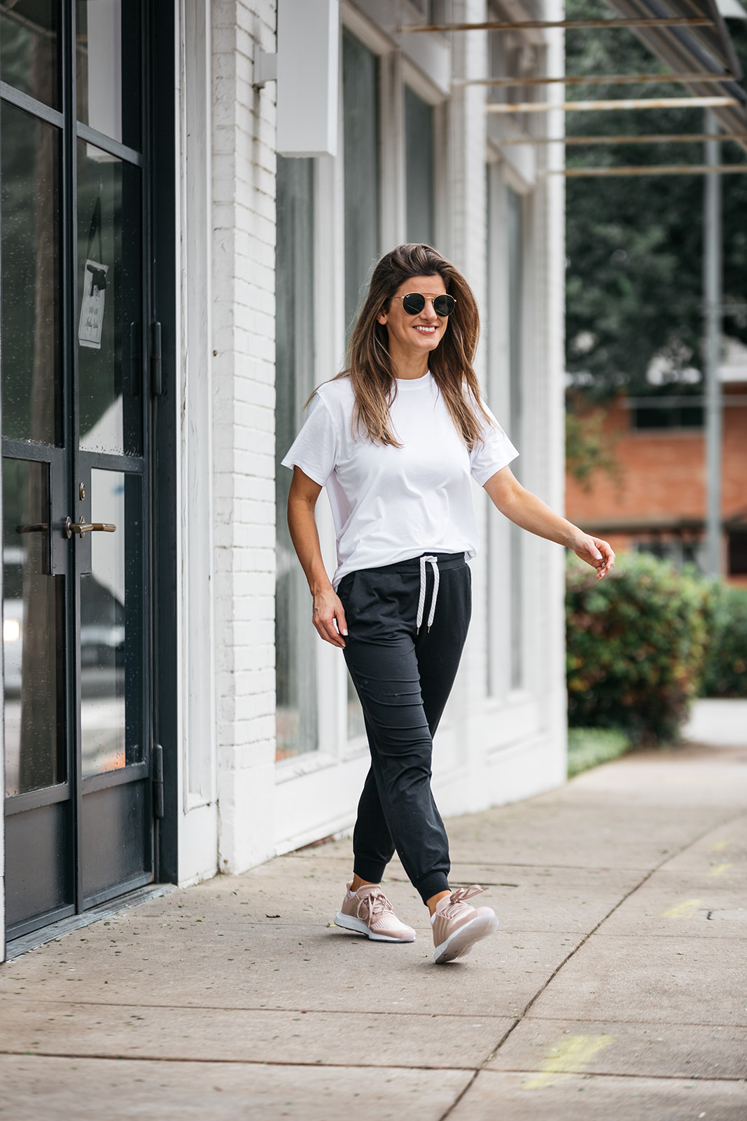 brighton butler wearing vuori jogges and lululemon all yours tee and adidas swift run sneakers