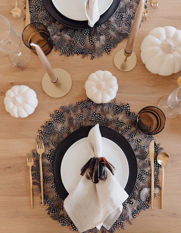 Brighton Butler Fall Tablescape with black and white plates and feather placemat