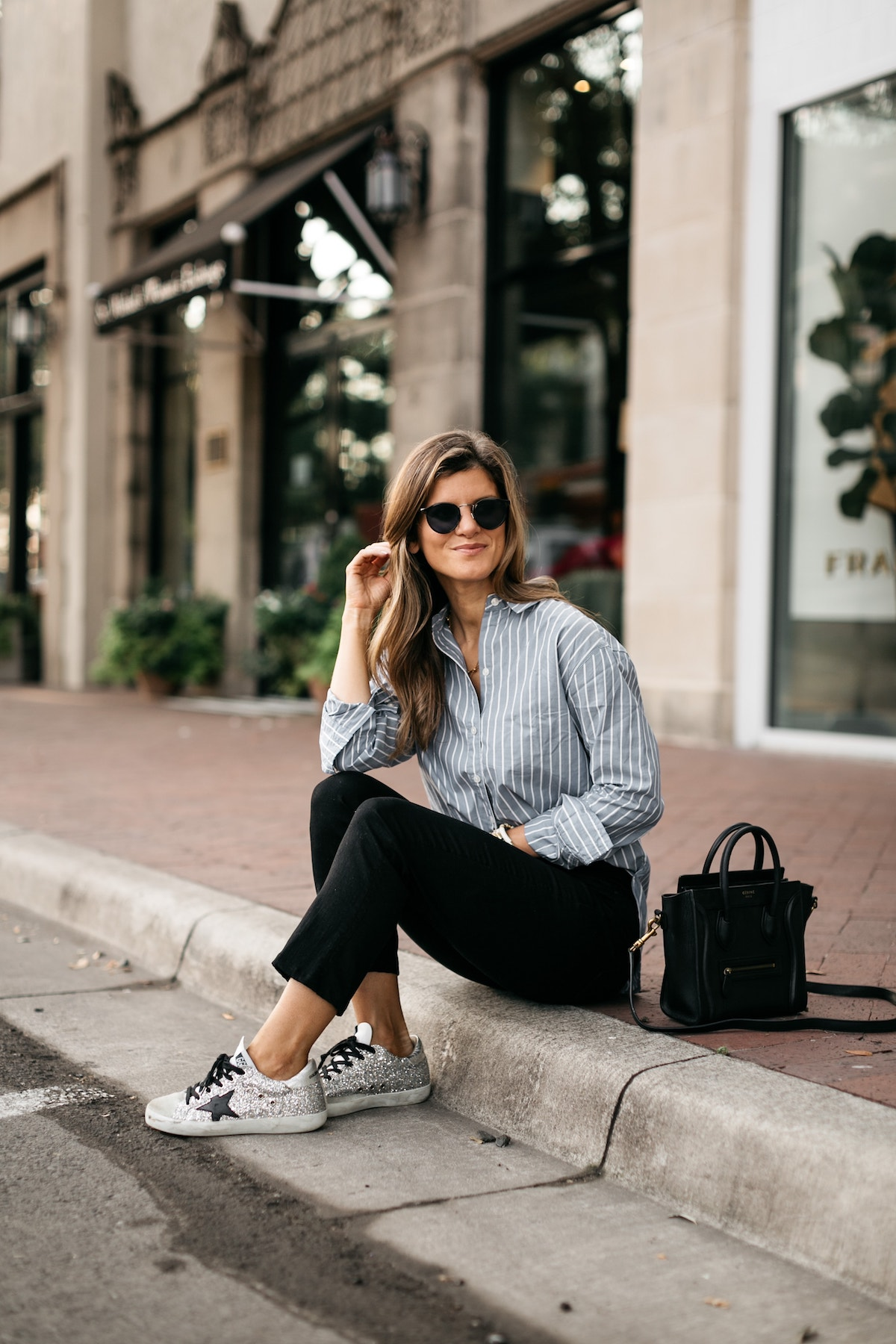 Brighton Butler wearing Abercombie striped shirt, black jeans and golden goose sneakers silver glitter with black star and black laces