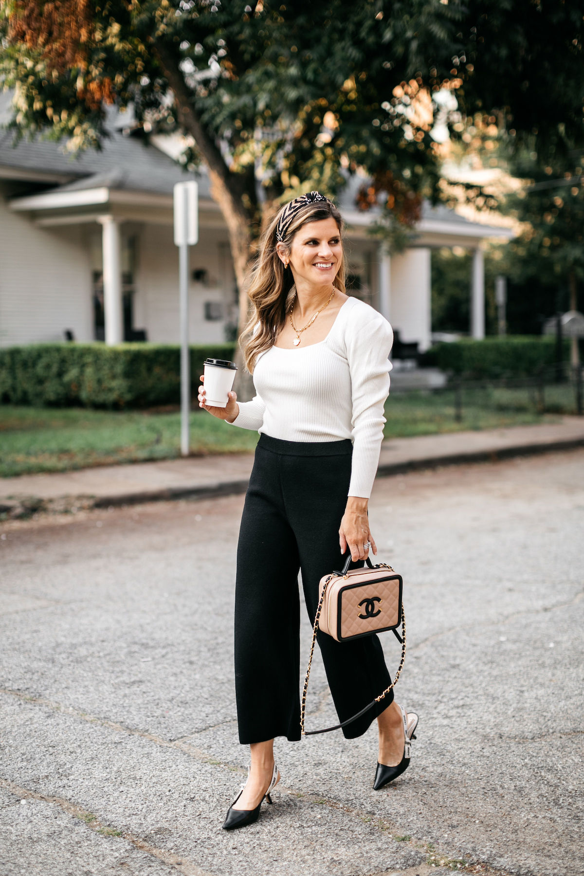 work outfit brighton butler wearing jcrew black pants and cream sweater businss casual 1a